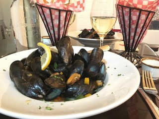 Typical french dishes, moules frites at the Cafe Meteor Bistro
