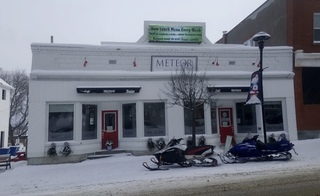 Parking in front of the Cafe Meteor Bistro with your snowmobile